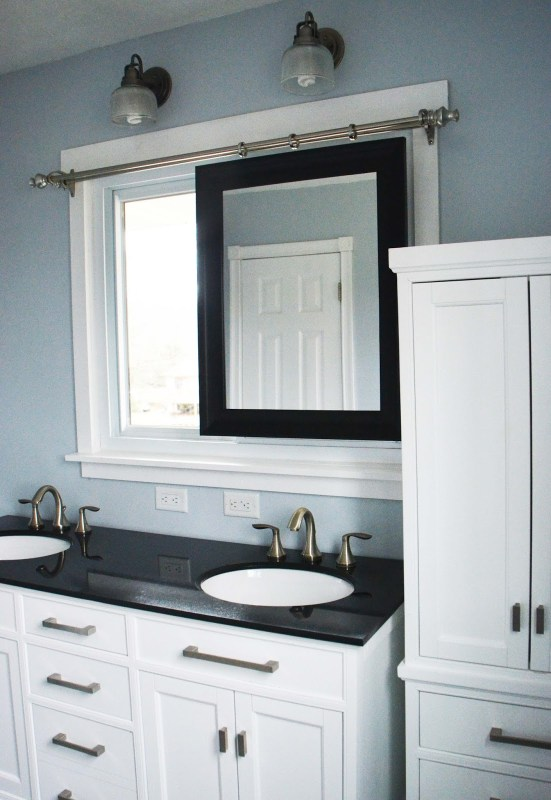 Bathroom Remodel, sliding mirror, tall linen cabinet, by Since I Became a Mom featured on @Remodelaholic