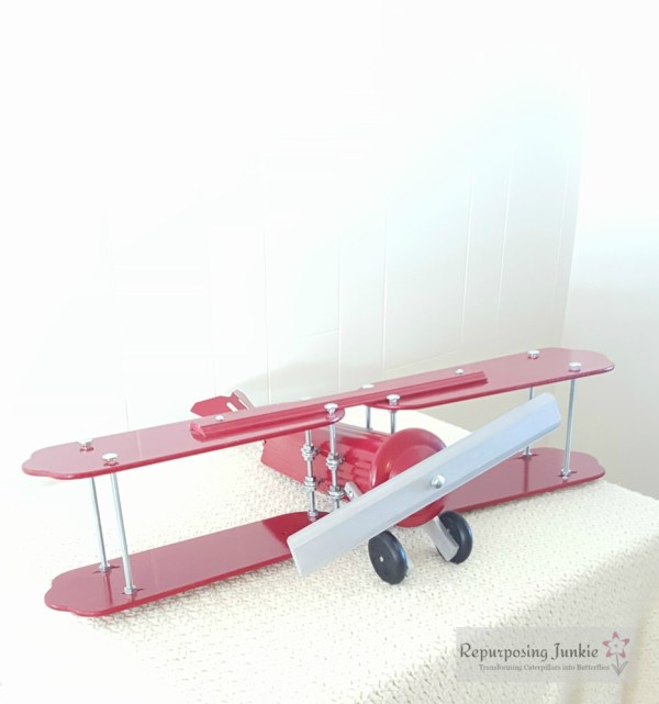 18 Build decorative airplane from repurposed ceiling fan blades, front view 4, by Repurposing Junkie featured on @Remodelaholic