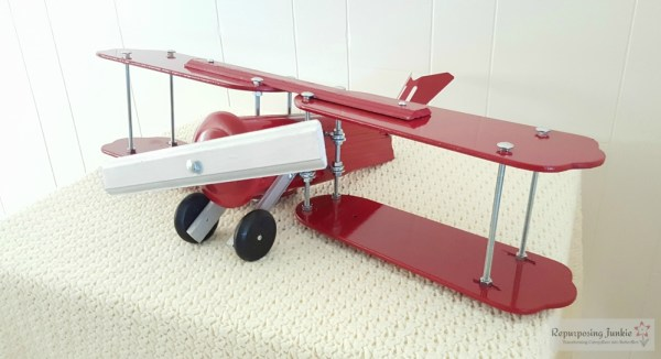 22 Build decorative airplane from repurposed ceiling fan blades, side view 2, by Repurposing Junkie featured on @Remodelaholic