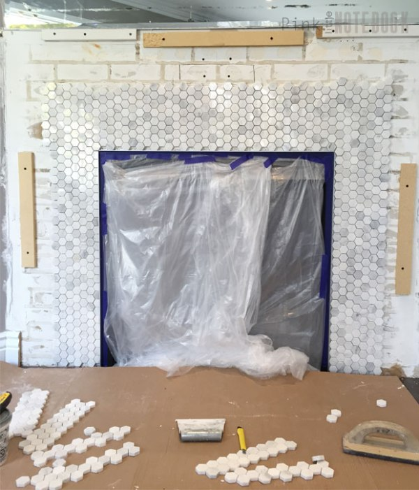 marble tile used in fireplace surround, DIY mantel update Pink Little Notebook featured on @Remodelaholic
