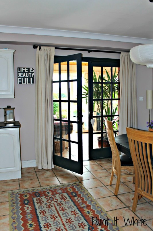 8 7 Pine french doors updated to dark gray, walls in Parisian Cream by Dulux, after, by Paint it White featured on @Remodelaholic