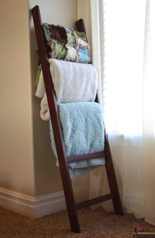 Super easy to build! DIY blanket ladder to store blankets and throws without piling them on the ground. Could be used for towels in the bathroom, too.