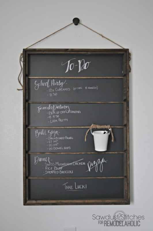 Build this awesome chalkboard organizer for around $25, perfect for a menu board or kids' art station. Tutorial from Sawdust2Stitches on Remodelaholic.com