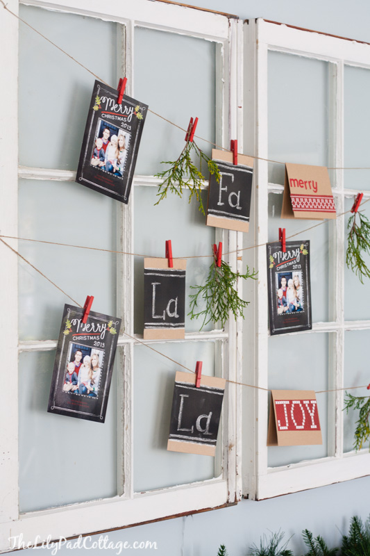 hang Christmas cards across a set of old windows The Lily Pad Cottage