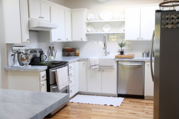 white kitchen makeover with marble tile countertops and subway tile backsplash