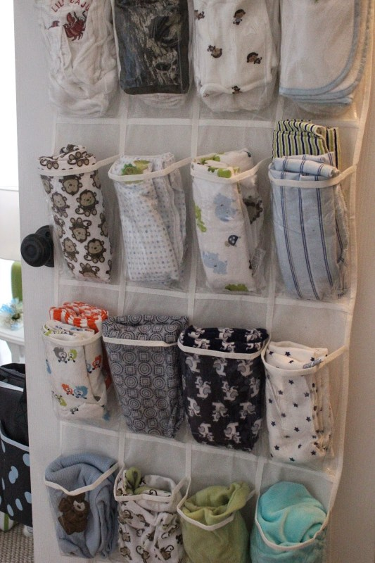 Store baby blankets and/or burp cloths in a shoe organizer on the back of the door. Why did I not think of that?!?