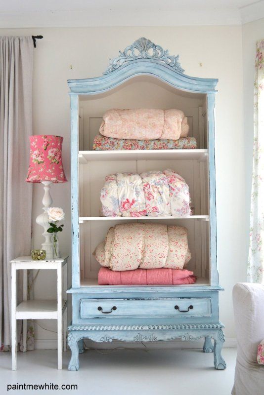 Old armoire into blanket storage. Perfect for a guest room!
