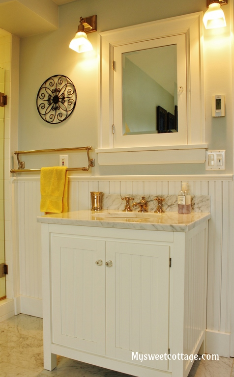 20 Pottery Barn carrera marble sink in remodeled bathroom of 1920s home, My Sweet Cottage featured on @Remodelaholic