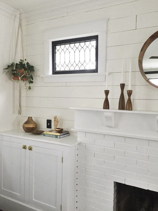 Gorgeous mantel update. Add bookshelves to each side, plank shiplap wall, and paint the window frames black. Carpendaughter on @Remodelaholic