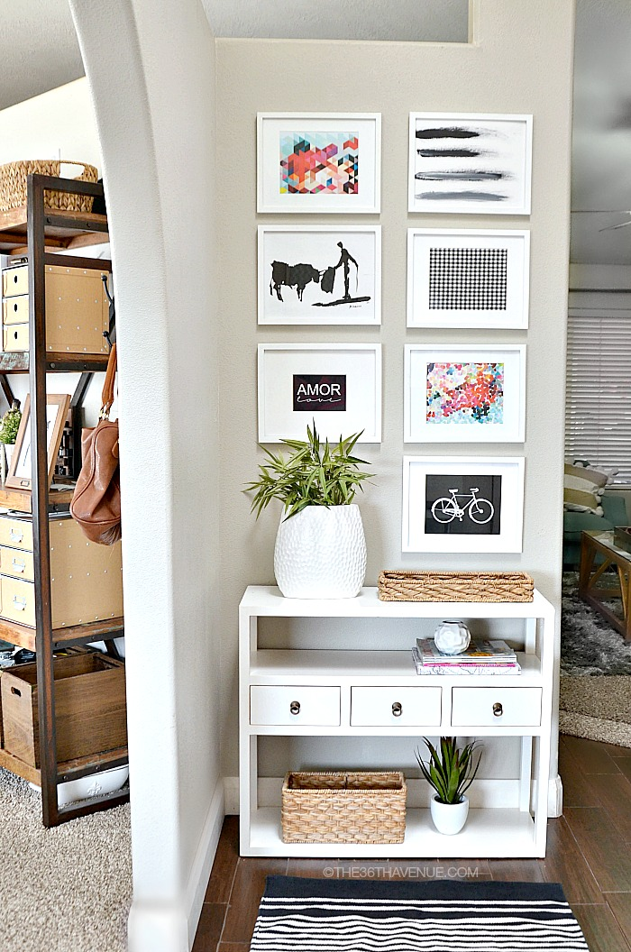 Cute entryway decor! Love the prints | 100+ Beautiful Mudrooms and Entryways at Remodelaholic.com