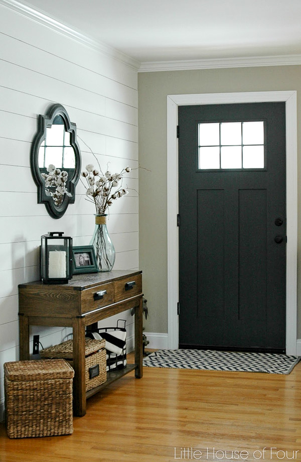 Black door and shiplap in the entryway, Fixer Upper style | 100+ Beautiful Mudrooms and Entryways at Remodelaholic.com