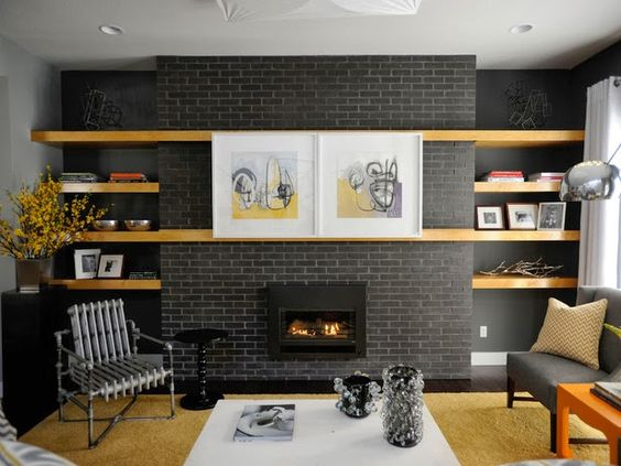 great shelves around the fireplace, and those art canvases are hiding the TV!