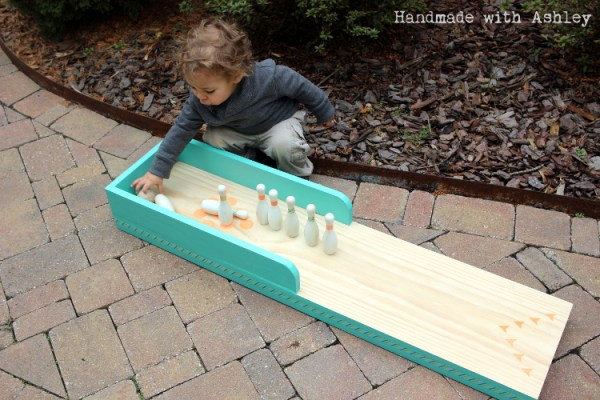 2 Tutorial for kid-sized bowling lane out of scrap wood, Handmade by Ashley featured on @Remodelaholic