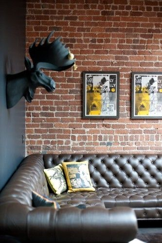exposed brick wall + leather sofa. Need this!