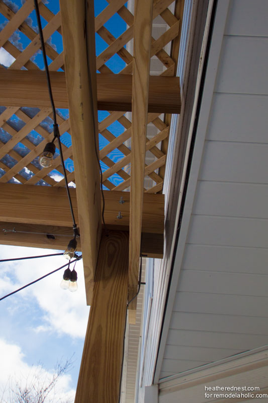 Beautiful DIY pergola, full how-to and tutorial from The Heathered Nest on Remodelaholic.com
