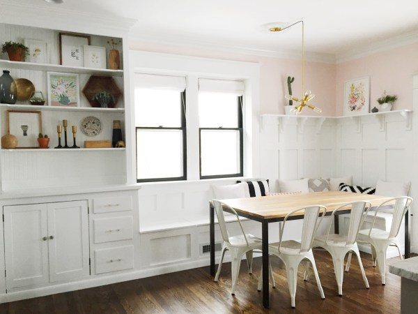 Gorgeous pink and white dining room banquette plus built-in hutch. The paneled board and batten below the ledge is gorgeous above the banquette!