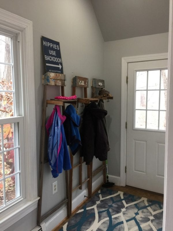 Brilliant! Use old ladders as a coat rack for the entry | 100+ Beautiful Mudrooms and Entryways at Remodelaholic.com