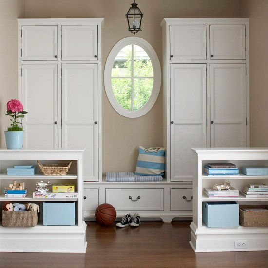 Lots of storage in a mudroom alcove, separated a bit by a knee wall or half wall with storage | 100+ Beautiful Mudrooms and Entryways at Remodelaholic.com