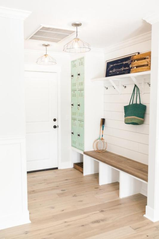 large white mudroom, shoplap, lockers, and a storage bench. LOVE! | 100+ Beautiful Mudrooms and Entryways at Remodelaholic.com