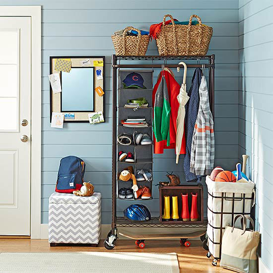 organized entryway with a rolling coat rack closet and baskets | 100+ Beautiful Mudrooms and Entryways at Remodelaholic.com