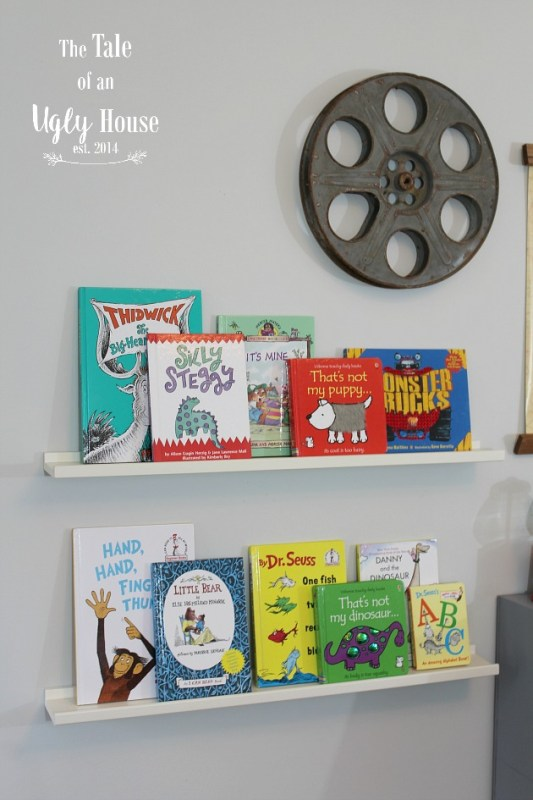 Toddler boy bookshelves and decor by Tale of an Ugly House featured on @Remodelaholic