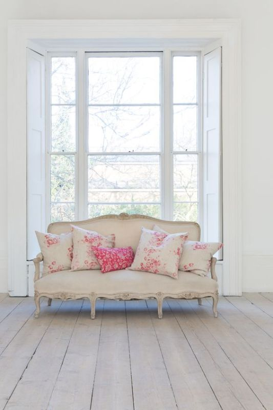French couch with pretty pink floral pillows by Cabbage & Roses