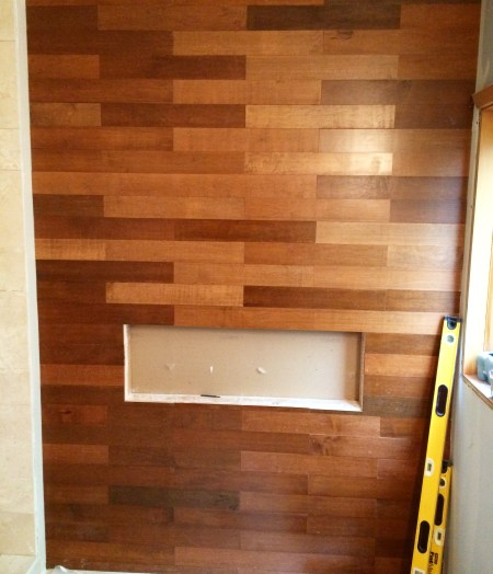 how to install a stacked brick pattern stained wood plank wall