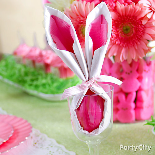 Use napkins and an egg to make a cute Easter bunny, great for Easter dinner! via Party City