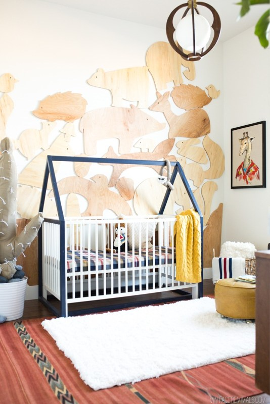 baby boy nursery with IKEA hack crib and wooden animals on the wall Vintage Revivals