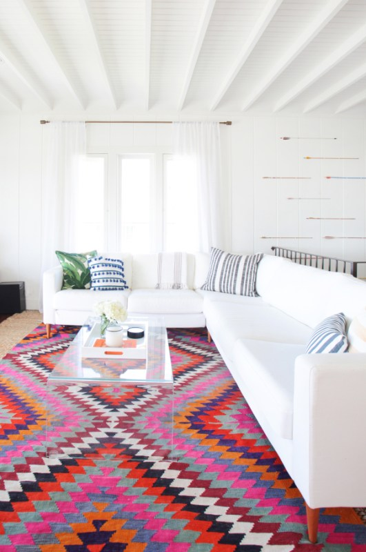 white and colorful southwestern style living room via StyleMePretty, photo Tessa Neustadt