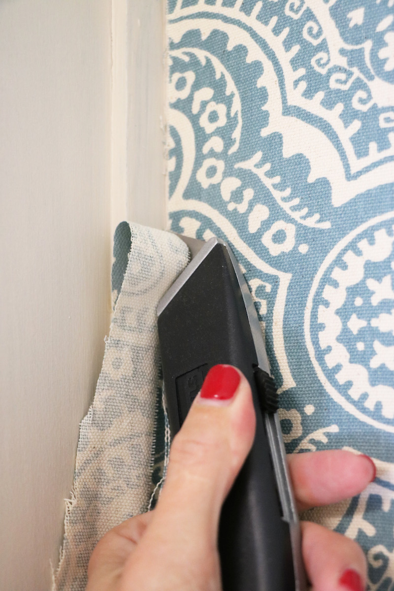 Trimming starched fabric wall