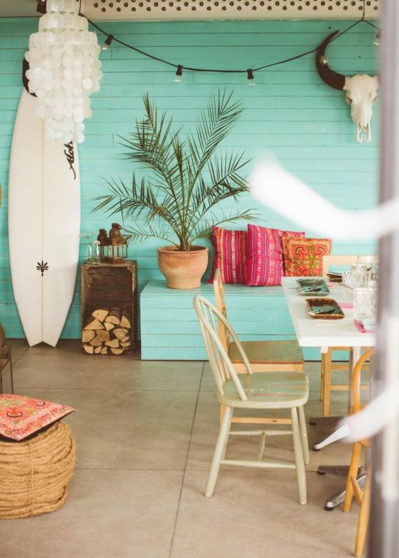 Turquoise plank wall beach house | Modern Tropical Style on Remodelaholic.com