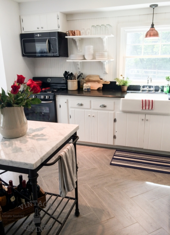 Herringbone floors in white kitchen renovation, by Vintage Refined featured on @Remodelaholic