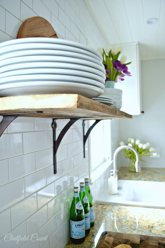 Plank ceiling in white kitchen, DIY, by Chatfield Court featured on @Remodelaholic