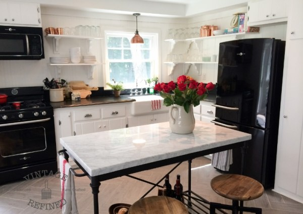 Amazing kitchen remodel diy, white kitchen with black appliances, by Vintage Refined featured on @Remodelaholic