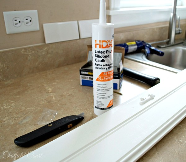 How to install a plank ceiling, silicone caulk for securing plank ceiling, by Chatfield Court featured on @Remodelaholic