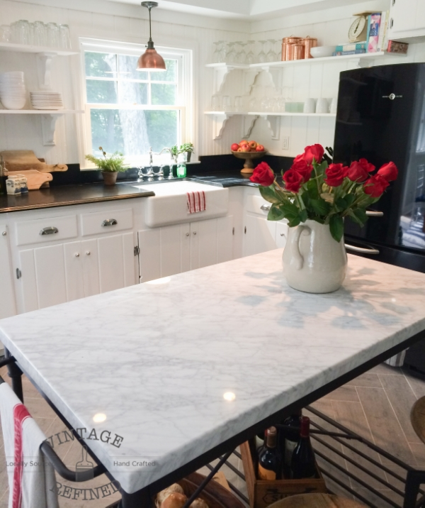 Marble top and open bottom completely transform the island in this white kitchen!, by Vintage Refined featured on @Remodelaholic