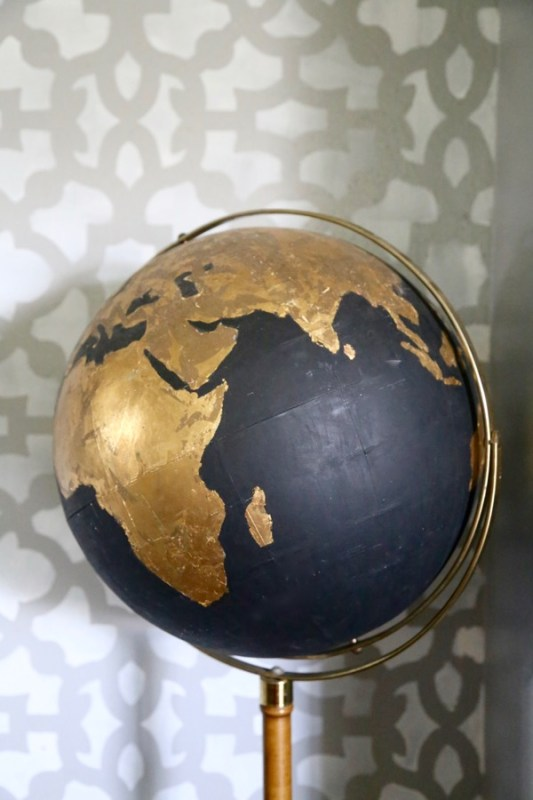 A thrift store globe gets a glamorous and easy update with just craft paint and gold foil.