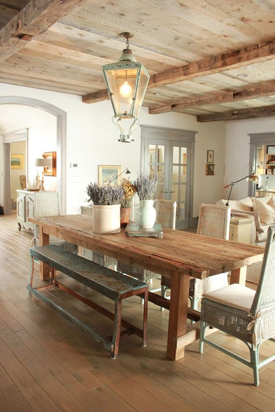 Farmhouse Dining Room With Rustic Table And Bench And Open Beams Via