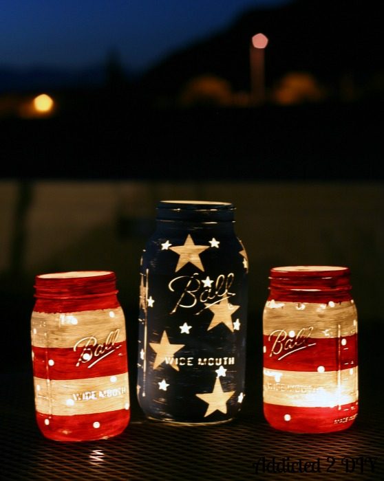 super cute summer patriotic decor, stars and stripes painted mason jars! by Addicted 2 DIY