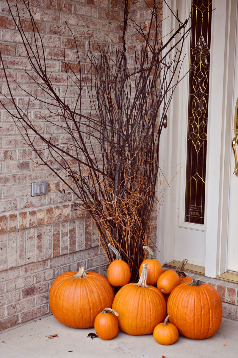 Easy Halloween porch decor, spray painted branches and pumpkins | Simple Halloween Decor Ideas and Tutorials at Remodelaholic.com