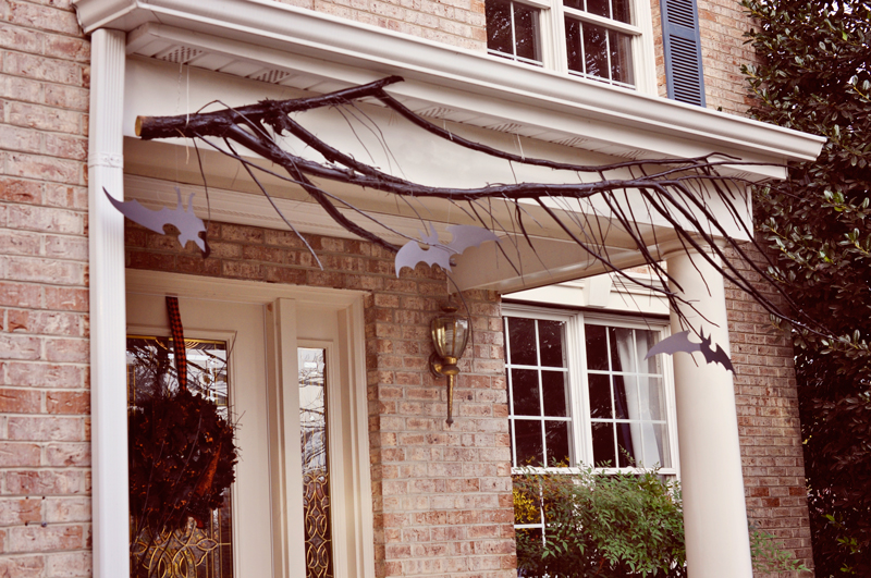 Branches hung from the porch and cardboard or paper bats, so easy! | Simple Halloween Decor Ideas and Tutorials at Remodelaholic.com