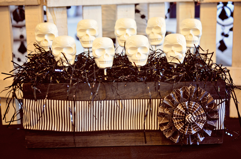 Halloween party food, cakes and skull pop treats and a simple backdrop | Simple Halloween Decor Ideas and Tutorials at Remodelaholic.com