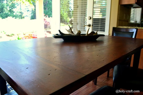 Tutorial for a planked table top to cover stains, paint and damage on an existing table by Rachel Teodoro at Holy Craft featured on @Remodelaholic