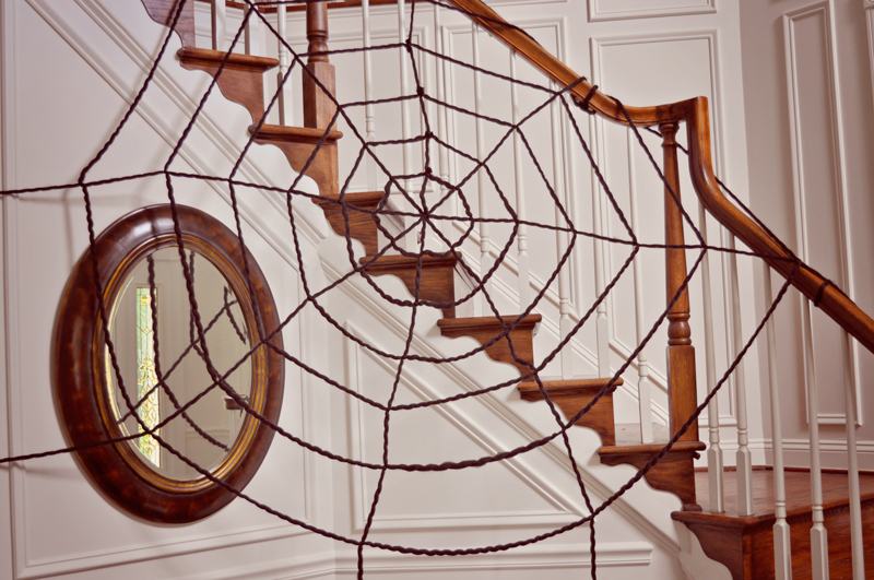 How to make an extra large spider web | Easy decor for a Halloween party: an oversized yarn spiderweb, so easy to make but such a big impact! | Simple Halloween Decor Ideas and Tutorials at Remodelaholic.com