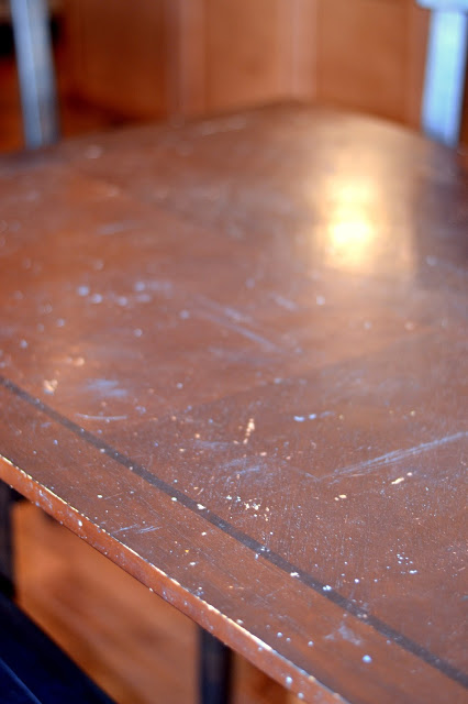 A budget-friendly, DIY solution for stained, damaged table top by Rachel Teodoro at Holy Craft featured on @Remodelaholic