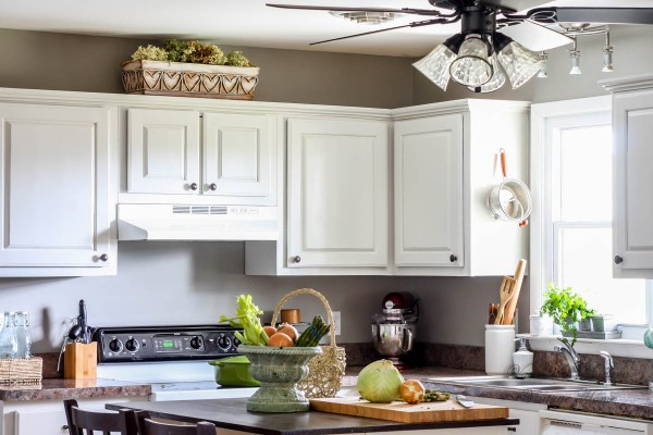 Tutorial for painting kitchen cabinets without removing the doors by Vanessa's Modern Vintage Home featured on @Remodelaholic
