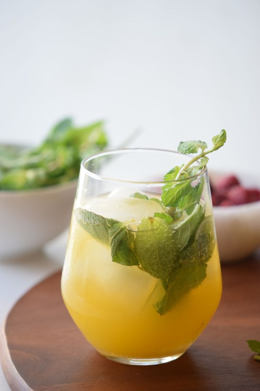 Simple drink to stay cool in a healthy way with a mango basil spritzer