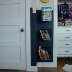 Books on Hooks- such a clever storage solution for a useless corner!
