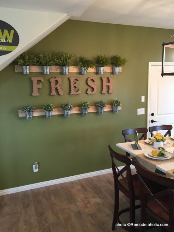 easy wall of herbs made from cheap IKEA buckets via @remodelaholic 2